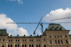 Construction cranes is in the center of Moscow. Royalty Free Stock Photo