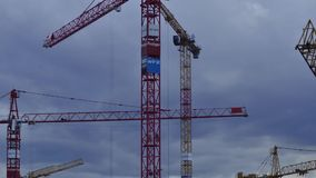 Construction cranes stock video footage