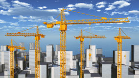 Construction cranes in a city landscape Stock Image