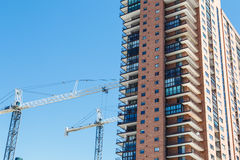 Construction Cranes by Condo Tower Stock Images