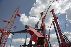 Construction cranes on construction machinery exhibition Royalty Free Stock Photos