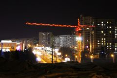 Construction cranes at a construction site, colored light at night, lights and LEDs. Outdoors royalty free stock photo