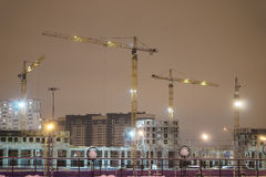 Construction cranes on the construction site Royalty Free Stock Photos