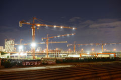 Construction cranes in a construction site Stock Images
