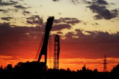 Construction cranes in evening Stock Photo