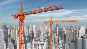 Construction cranes in front of a city landscape Royalty Free Stock Photo