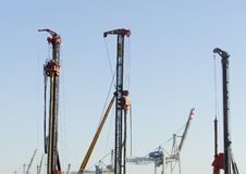 Construction cranes in harbor on blue sky royalty free stock image
