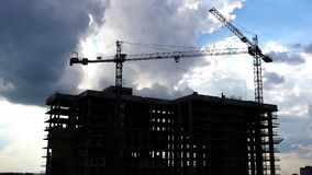Construction Cranes Industrial Timelapse Video. This stock footage presents the time lapse of a construction site. It shows two huge cranes lifting construction stock video