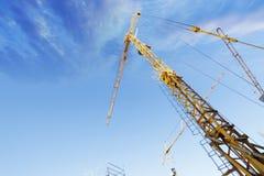 Construction -cranes inside building-site Royalty Free Stock Photos