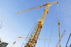 Construction -cranes inside building-site Stock Images
