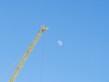 Construction cranes and  Moon Stock Image