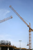 Construction cranes in operation. In downtown kuwait stock photography