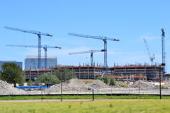 Construction cranes over a building in progress Royalty Free Stock Images