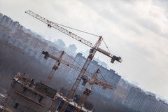 Construction cranes over buildings Royalty Free Stock Photos