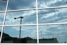 Construction cranes reflection Stock Images
