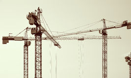Construction cranes silhouettes. Royalty Free Stock Image