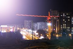 Construction cranes at a construction site, colored light at night, lights and LEDs. Outdoors stock photos