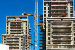Construction cranes and tall buildings Stock Photography