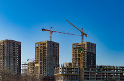 Construction cranes and tall buildings Royalty Free Stock Photos