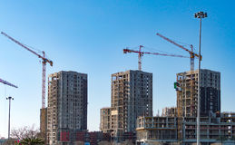 Construction cranes and tall buildings Royalty Free Stock Images