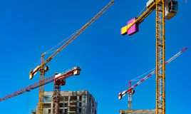 Construction cranes and tall buildings Stock Photos