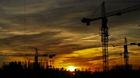 Construction cranes timelapse stock video footage