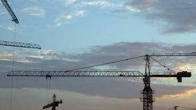 Construction cranes timelapse stock video footage