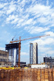 Construction cranes. Cranes towering over a high rise construction project in a busy work zone downtown in fast growing Austin, the capital city of Texas Royalty Free Stock Photos