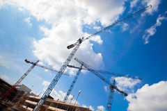 Construction cranes and unfinished building Stock Photography