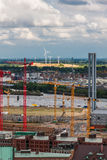 Construction cranes and wind turbines in Hamburg Stock Photography