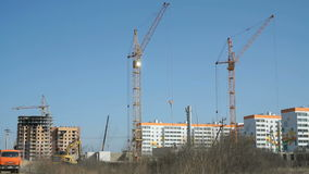 Construction cranes work at construction site stock video