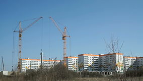 Construction cranes work on construction site stock video footage