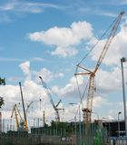 Construction with cranes working equipment royalty free stock photography