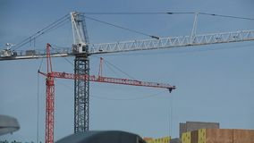 Construction Cranes Working in Time Lapse. Two construction cranes working on an apartment building shot in time lapse stock footage