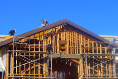 Construction Crew-framing project. Men working on roof lines for commercial construction project Royalty Free Stock Photos