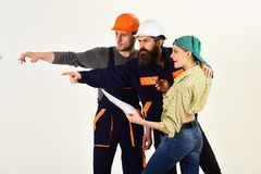 We are the construction crew. People working together on construction design. Construction workers team. Men and woman. We are the construction crew. People royalty free stock photography