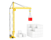Construction of Cubes by Yellow Tower Crane Royalty Free Stock Image