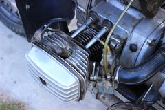Heavy motorcycle. The construction of the cylinder of the old motorcycle. Air cooling system Royalty Free Stock Photo