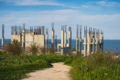 Construction d'une maison sur le bord de la mer Images stock