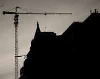 Construction de bâtiments au coucher du soleil Photographie stock libre de droits