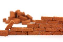 Construction de mur de briques d'isolement Photographie stock