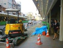 Construction de routes, mini bêcheur Photos stock