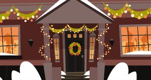 Construction de vacances de Front Door With Wreath Winter de Chambre, Joyeux Noël et concept décorés de bonne année Photographie stock libre de droits