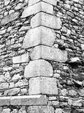 Construction detail of corner wall of old historical castle or ruin. Vintage architecture Royalty Free Stock Photo