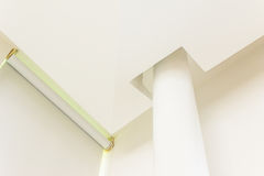 Construction details  - round pillar blind and complicated plastered board ceiling Stock Images