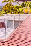Construction details : Tempered glass balustrades on wooden roof deck. Thailand Stock Photo