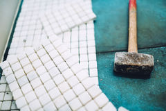 Construction details - Tools and mosaic tiles for home improvement, renovation close up Royalty Free Stock Image