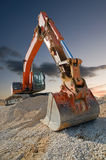 Construction Digger. Orange coloured heavy construction digger royalty free stock photos