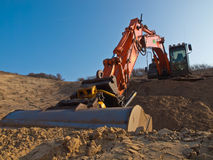 Construction digger in a sandpit Royalty Free Stock Photo