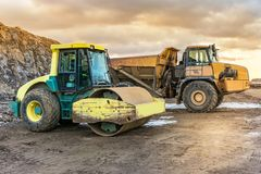 Construction of a dirt road in Spain through a truck and a steamrolle royalty free stock image